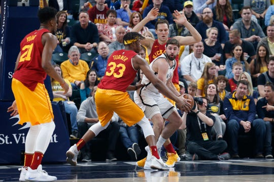 Apr 7, 2019; Indianapolis, IN, USA; Brooklyn Nets guard Joe Harris (12) is pressured by Indiana Pacers center Myles Turner (33) and forward Bojan Bogdanovic (44) during the first quarter at Bankers Life Fieldhouse.