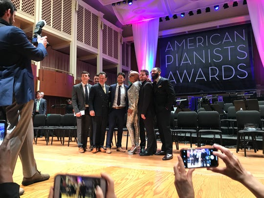 From left, finalist Keelan Dimick, finalist Dave Meder, singer Kurt Elling, winner Emmet Cohen, host Dee Dee Bridgewater, finalist Billy Test and finalist Kenny Banks Jr. pose after the concert on Saturday at Hilbert Circle Theatre.