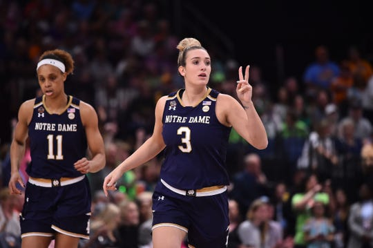 Apr 7, 2019; Tampa, FL, USA; Notre Dame Fighting Irish guard Marina Mabrey (3) celebrates after scoring against the Baylor Lady Bears during the first half in the championship game of the women's Final Four of the 2019 NCAA Tournament at Amalie Arena.