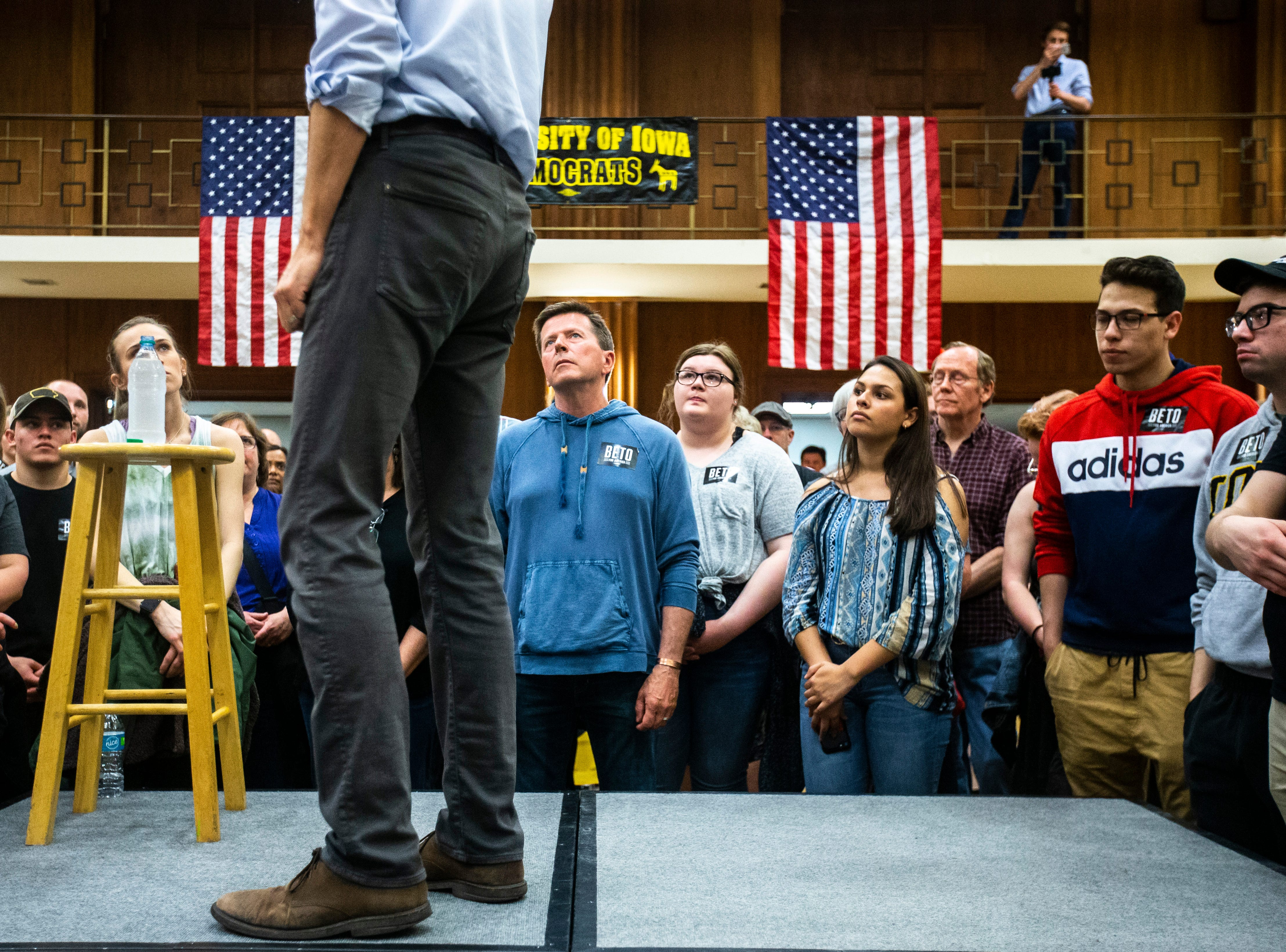 Community members listen as Democratic presidential candidate Beto O'Rourke of El Paso, Texas, speaks during a town hall event on Sunday, April 7, 2019, in the second floor ballroom at the Iowa Memorial Union on the University of Iowa campus in Iowa City, Iowa.