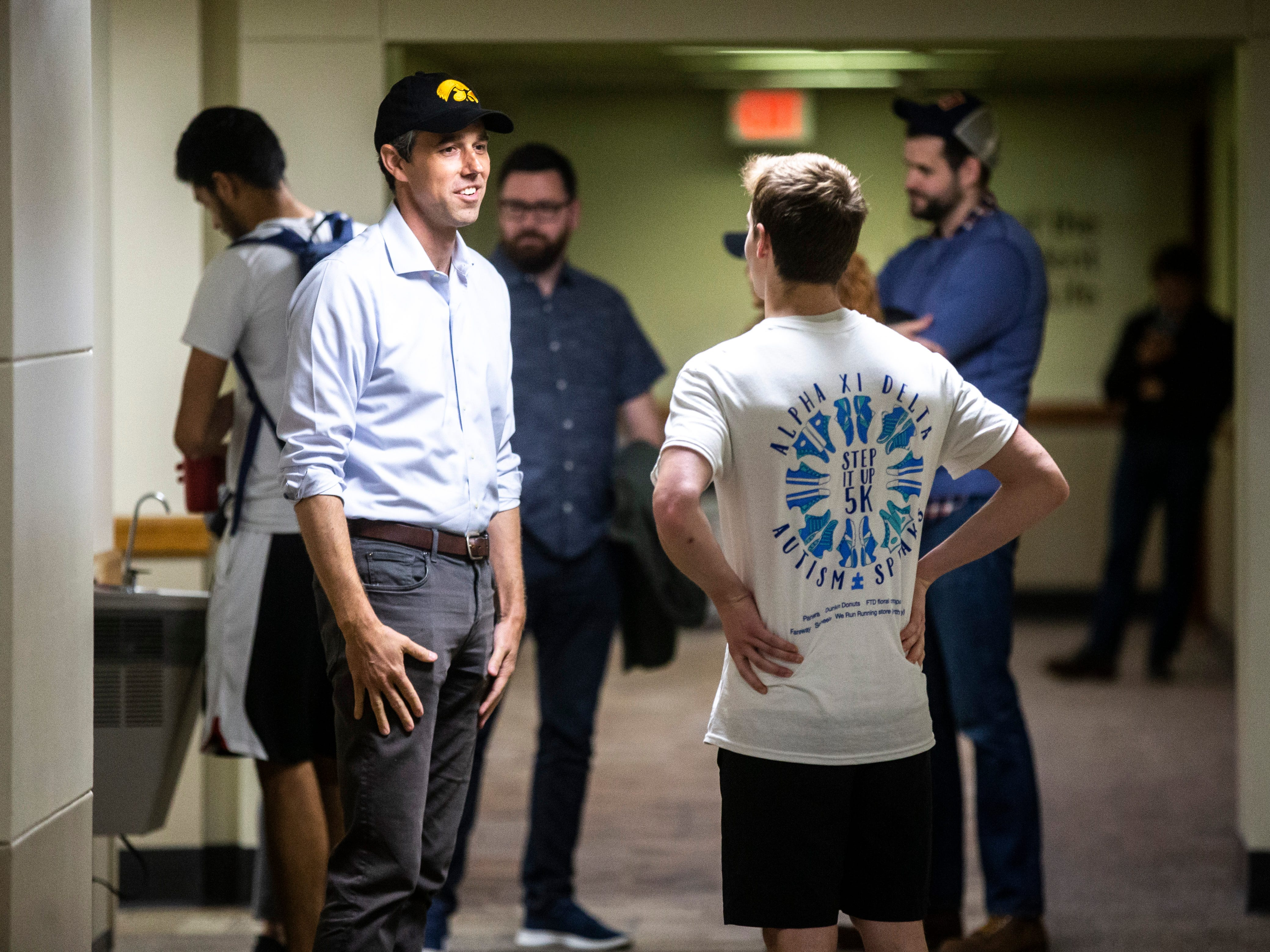 Democratic presidential candidate Beto O'Rourke of El Paso, Texas, talks with University of Iowa student Matthew Rowland after the two met in the restroom before a town hall event on Sunday, April 7, 2019, in the second floor ballroom at the Iowa Memorial Union on the University of Iowa campus in Iowa City, Iowa.