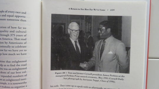 "A staff photo of a Cornell Daily Sun photo inside ""From Willard Straight to Wall Street: A Memoir."" The photo shows Tom Jones and James Perkins at the first Perkins Prize award ceremony."