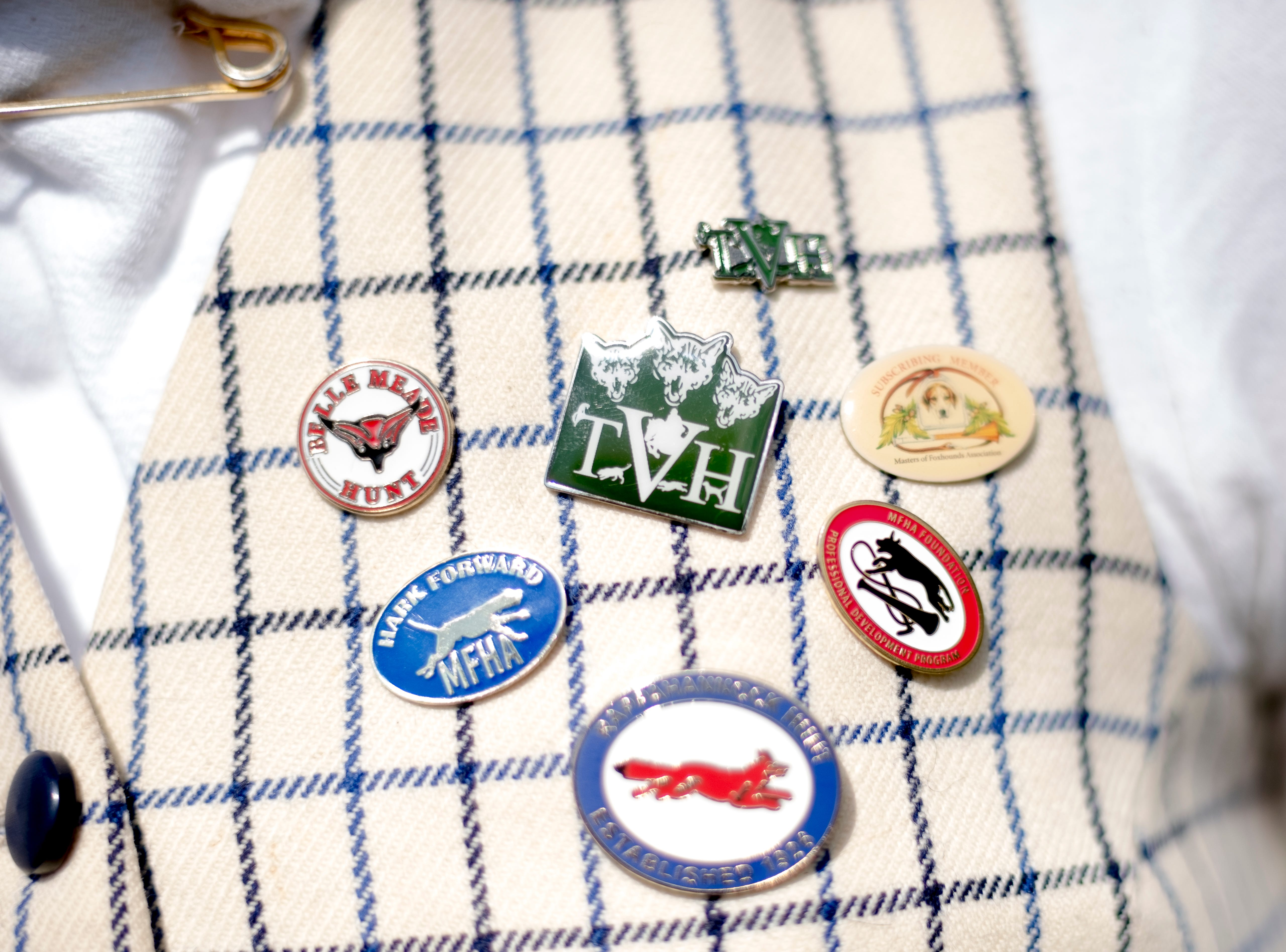 Casey Johnsey shows off her collection of fox hunting club pins during breakfast after a fixture at Riverplains Farm in Strawberry Plains, Tennessee on Wednesday, March 27, 2019.