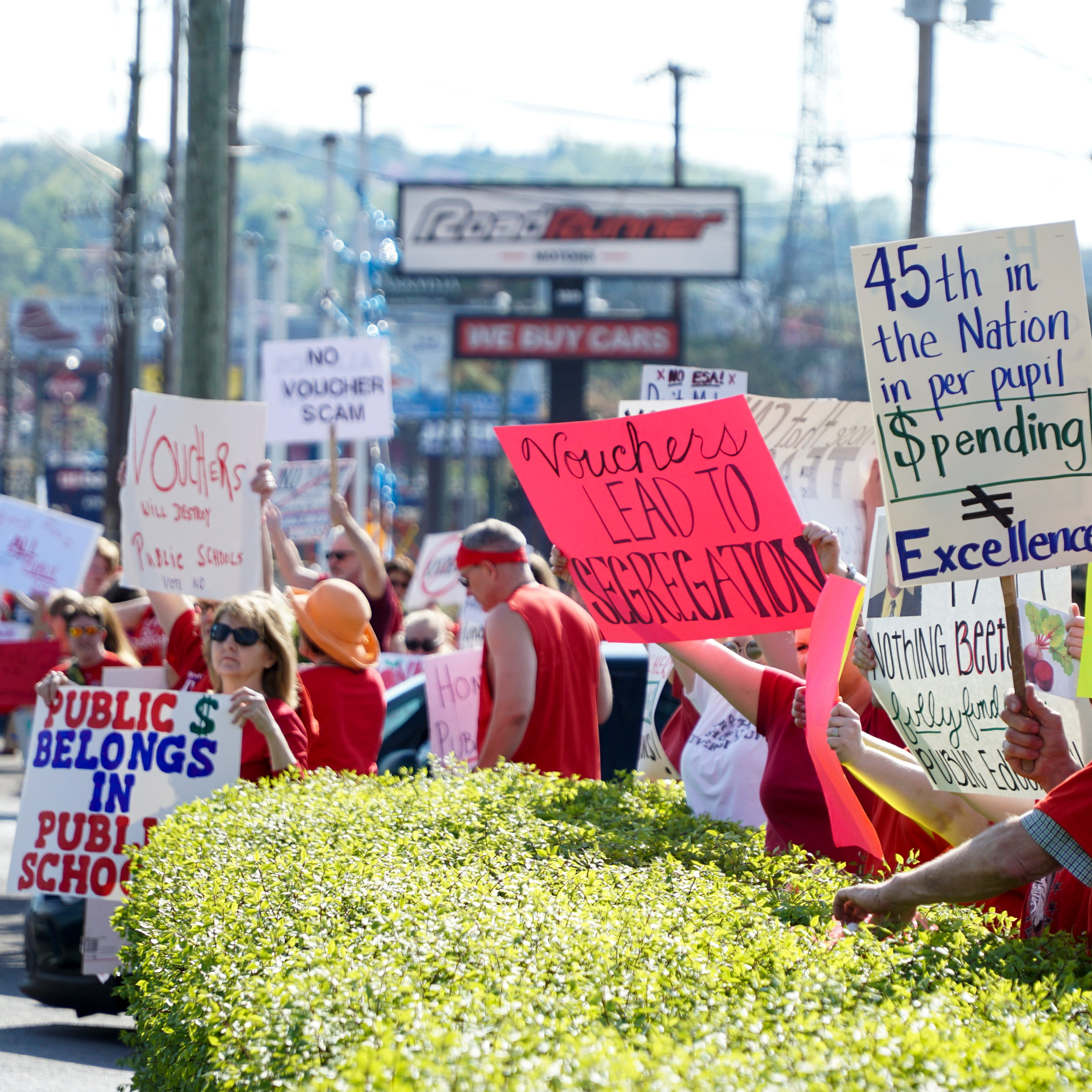 Anti-voucher demonstrators protest Gov. Bill Lee outside GOP dinner in Knoxville