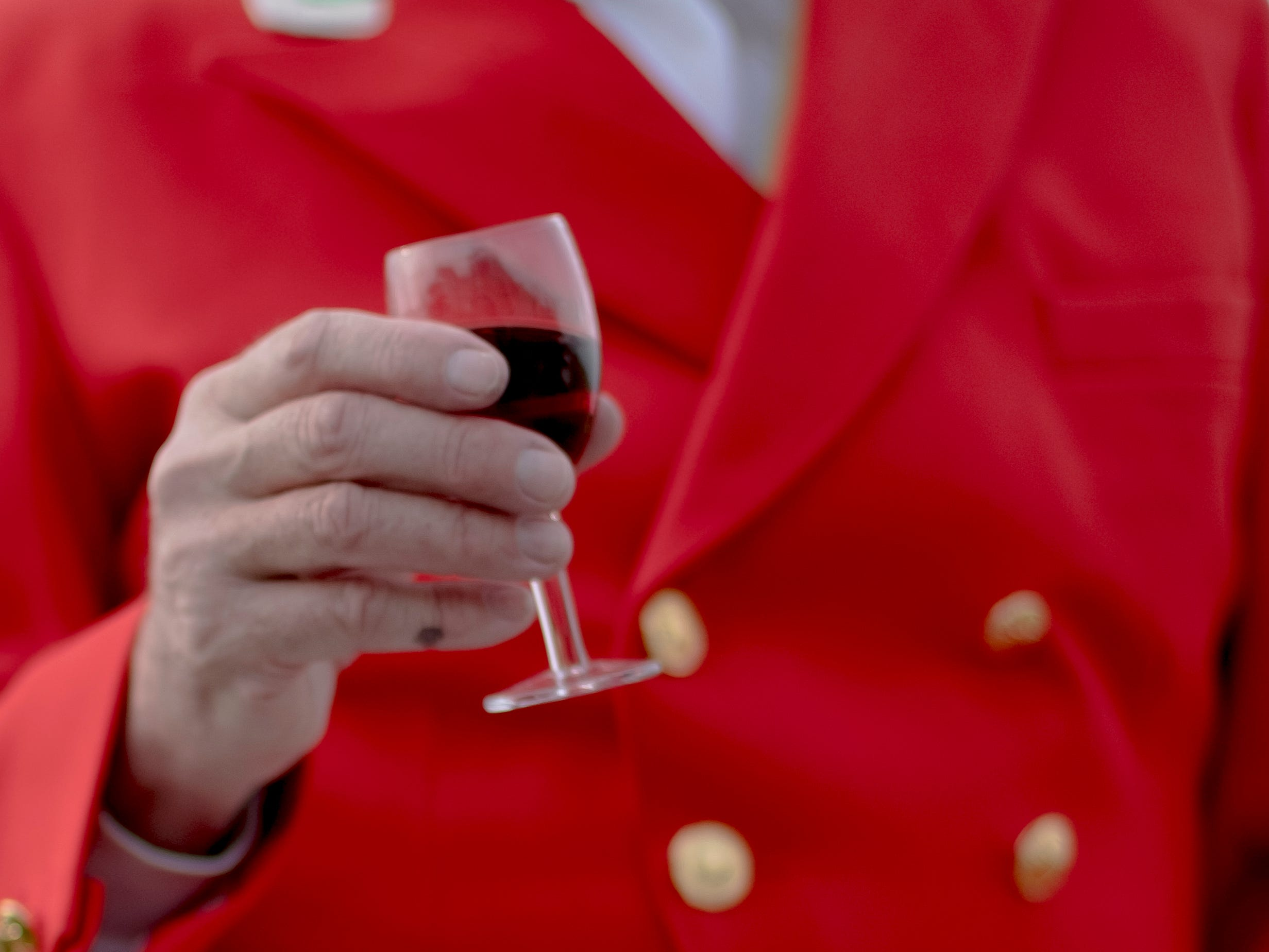 Scott Keeting, of Walland, enjoys a glass of port wine before the start of a fixture at Blackberry Ridge Farm in Greeneville, Tennessee on Saturday, March 30, 2019.