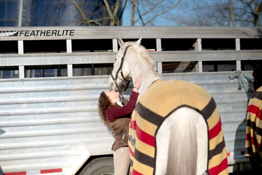 Jeanie Seaman loves on her horse during a fixture at Riverplains Farm in Strawberry Plains, Tennessee on Wednesday, March 27, 2019.