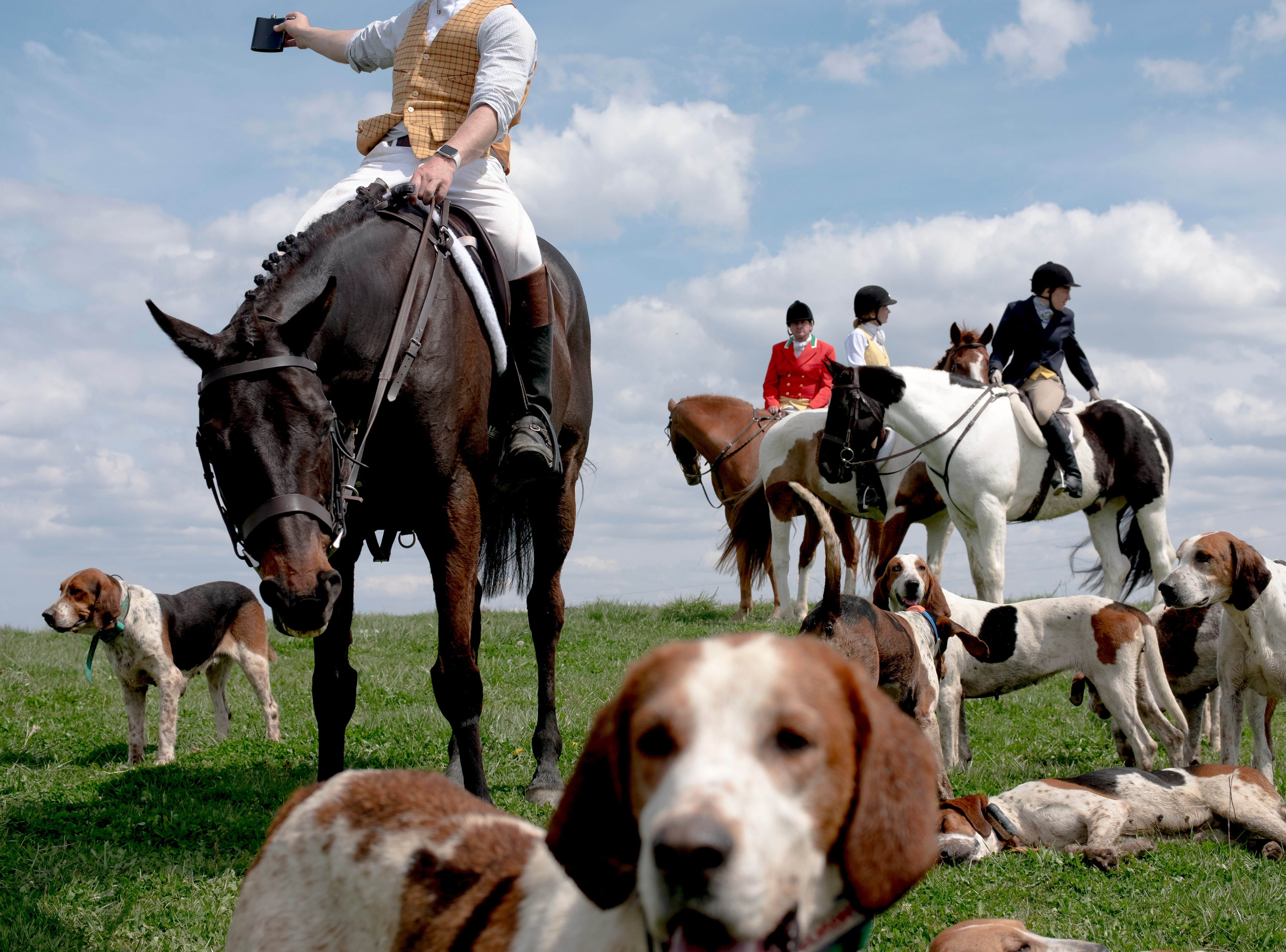 Fox hunters take a break in a meadow during a fixture at Blackberry Ridge Farm in Greeneville, Tennessee on Saturday, March 30, 2019.