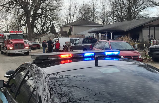 Lafayette police and firefighters work the scene of a stabbing and house fire, in which one person was found dead, early Sunday, April 7, 2019, at 818 S. 31st St. in Lafayette.