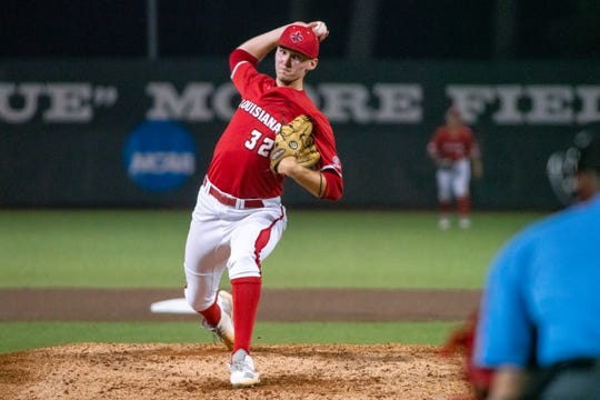 """UL's Brandon Young pitches to the batter as the Ragin' Cajuns take on the Arkansas State Red Wolves in a doubleheader at M.L. """"Tigue"""" Moore Field on Saturday, April 6, 2019."""