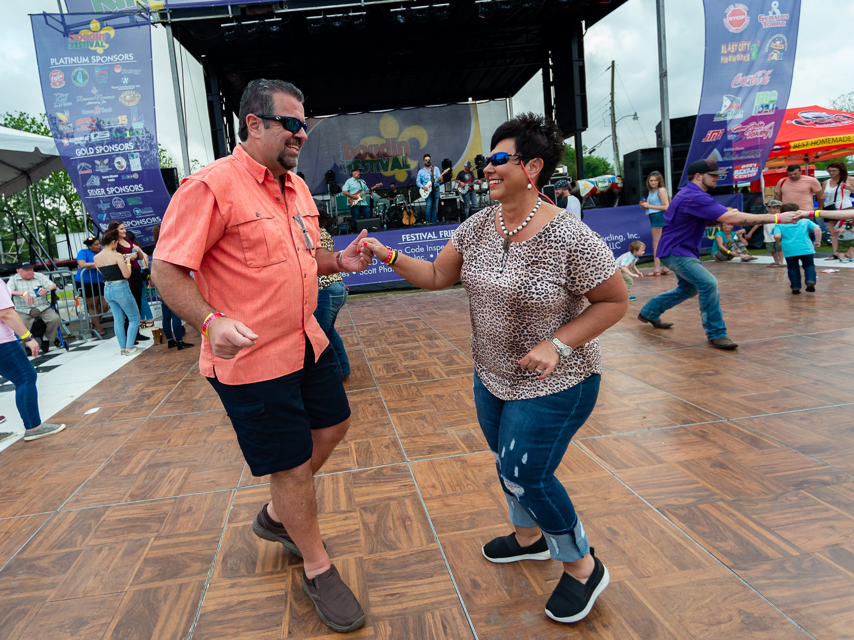 Kevin and Rena Johnson dancing as Dustin Sonnier performs at the Scott Boudin Festival. Saturday, April 6, 2019.