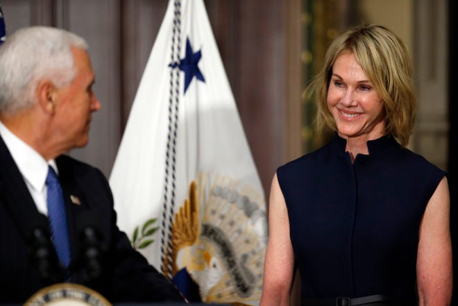 Vice President Mike Pence turns to speak to Kelly Knight Craft, during her swearing in ceremony to be U.S. Ambassador to Canada, in the Indian Treaty Room in the Eisenhower Executive Office Building on the White House grounds, Tuesday, Sept. 26, 2017, in Washington. (AP Photo/Alex Brandon)
