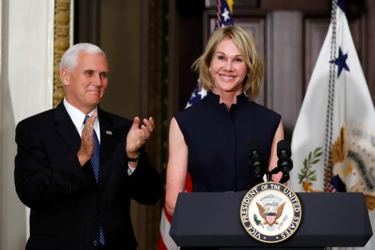 Vice President Mike Pence applauds as U.S. Ambassador to Canada Kelly Knight Craft concludes her remarks during her swearing in ceremony in the Indian Treaty Room in the Eisenhower Executive Office Building on the White House grounds, Tuesday, Sept. 26, 2017, in Washington. (AP Photo/Alex Brandon)