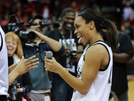 U of L's Asia Durr (25) laughs with her teammates following their 92-62 defeat of NC State at the Yum Center.  Durr requested a microphone again after forgetting to thank her family for attending senior night.