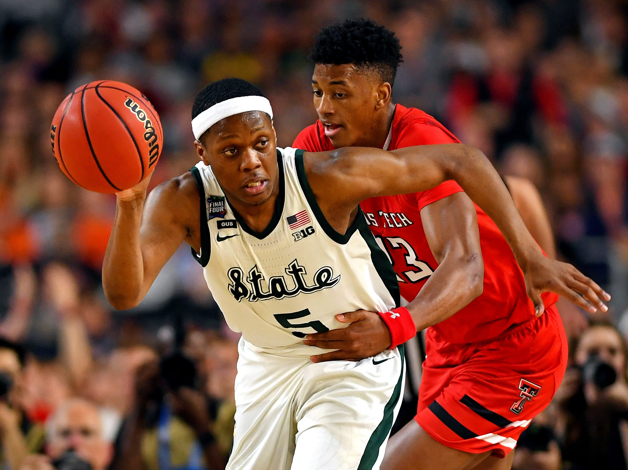 Apr 6, 2019; Minneapolis, MN, USA; Michigan State Spartans guard Cassius Winston (5) brings the ball up court against Texas Tech Red Raiders guard Jarrett Culver (23) during the second half in the semifinals of the 2019 men's Final Four at US Bank Stadium. Mandatory Credit: Bob Donnan-USA TODAY Sports