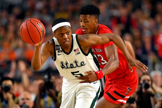 Apr 6, 2019; Minneapolis, MN, USA; Michigan State Spartans guard Cassius Winston (5) brings the ball up court against Texas Tech Red Raiders guard Jarrett Culver (23) during the second half in the semifinals of the 2019 men's Final Four at US Bank Stadium.