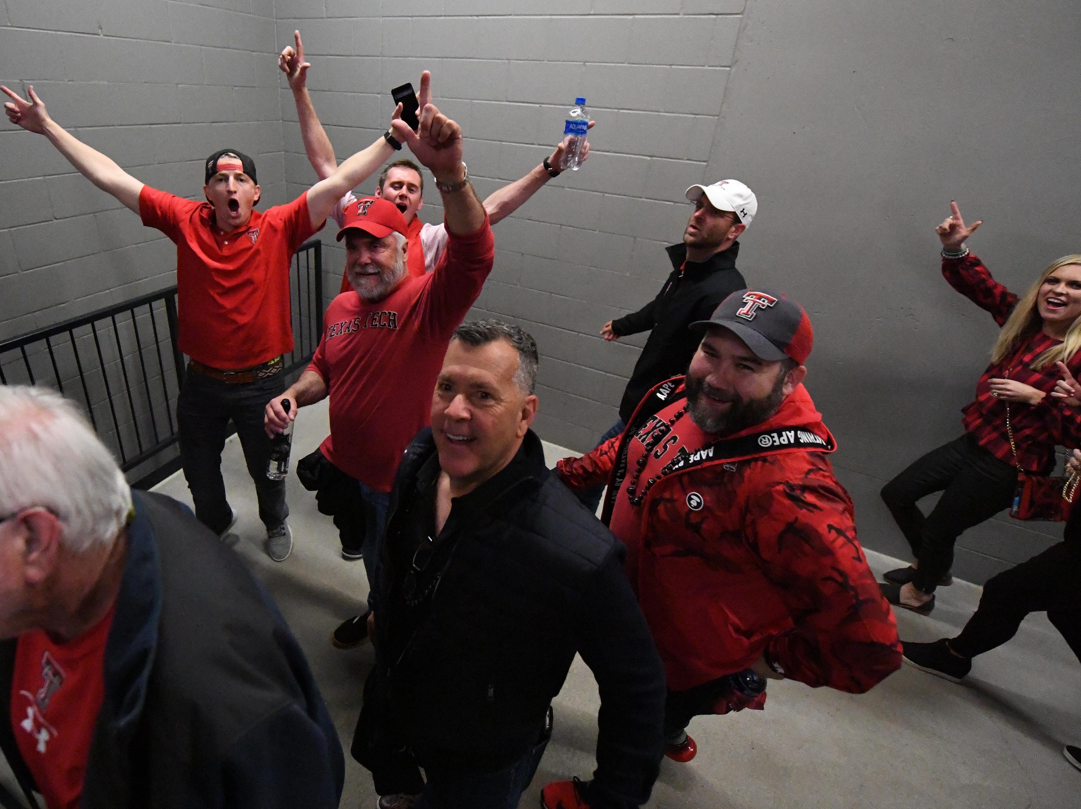 Apr 6, 2019; Minneapolis, MN, USA; Texas Tech Red Raiders fans celebrate after the semifinals of the 2019 men's Final Four against the Michigan State Spartans at US Bank Stadium. Mandatory Credit: Shanna Lockwood-USA TODAY Sports