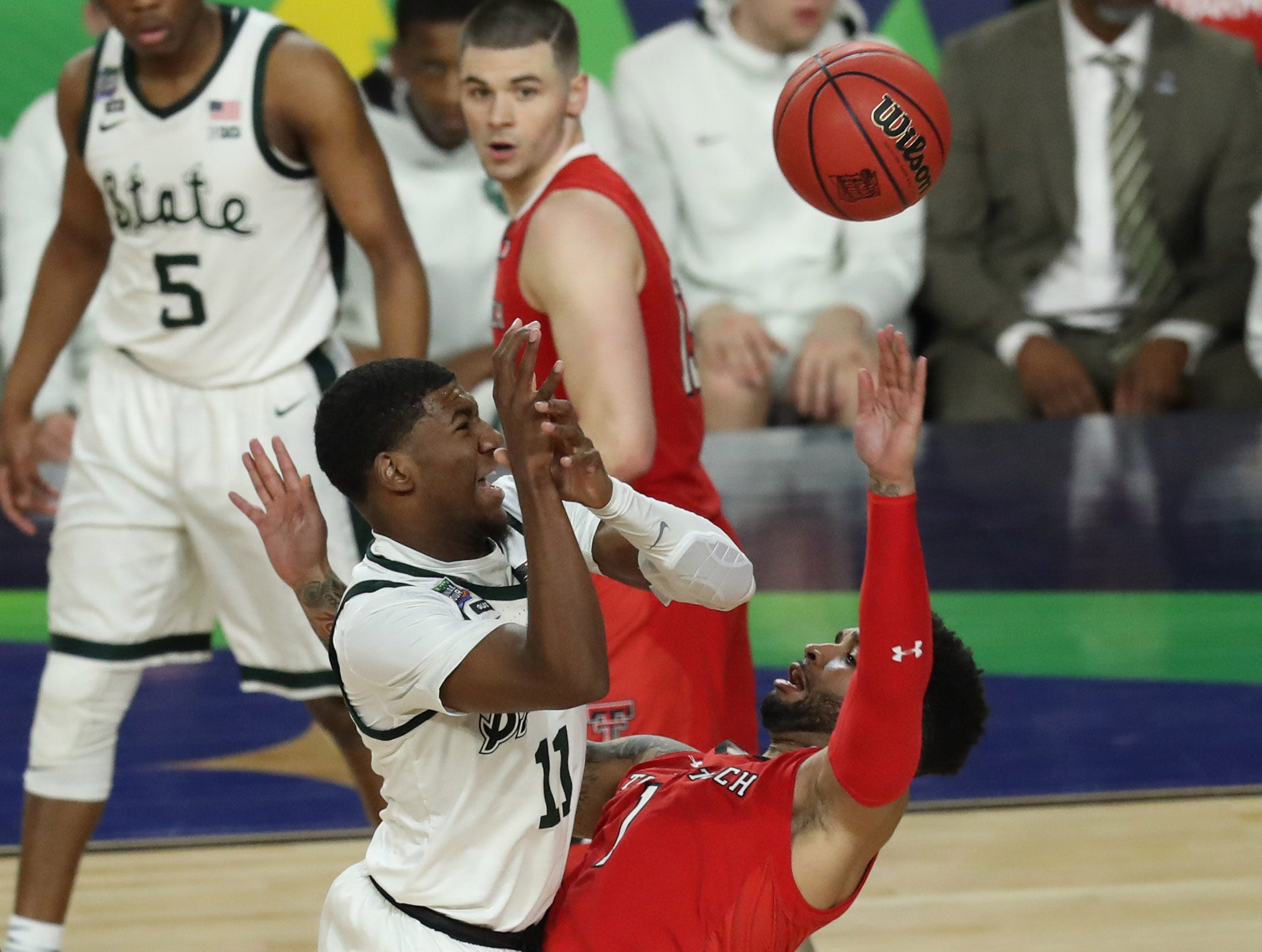 Apr 6, 2019; Minneapolis, MN, USA; Michigan State Spartans guard Matt McQuaid (20) attempts a shot over Texas Tech Red Raiders guard Brandone Francis (1) during the second half in the semifinals of the 2019 men's Final Four at US Bank Stadium. Mandatory Credit: Brace Hemmelgarn-USA TODAY Sports