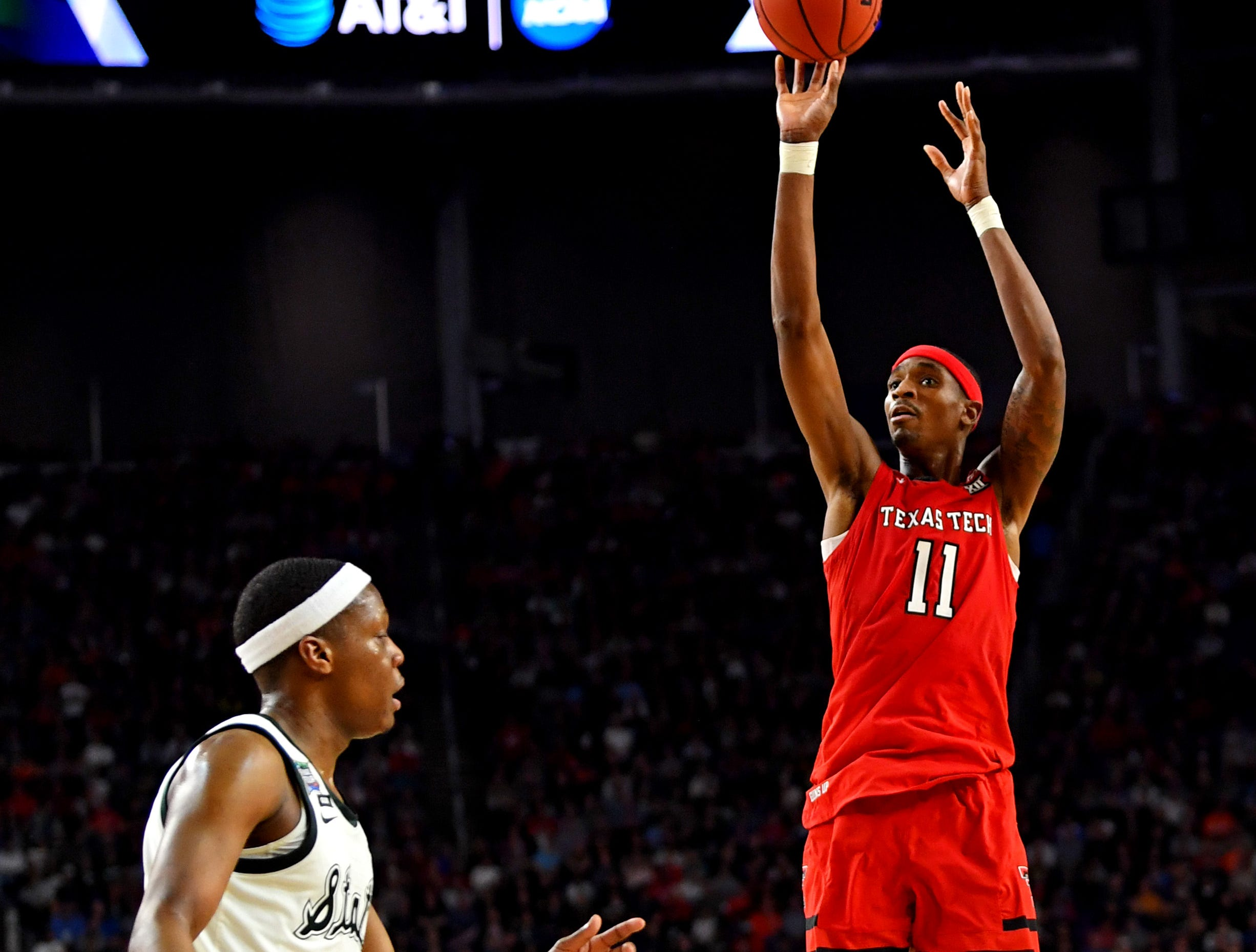 Apr 6, 2019; Minneapolis, MN, USA; Texas Tech Red Raiders forward Tariq Owens (11) shoots the ball against Michigan State Spartans guard Cassius Winston (5) during the first half in the semifinals of the 2019 men's Final Four at US Bank Stadium. Mandatory Credit: Bob Donnan-USA TODAY Sports