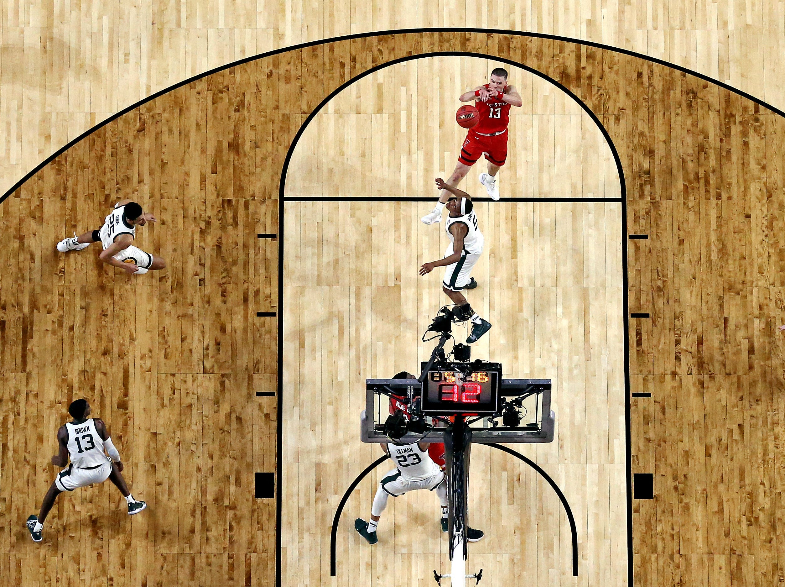 Apr 6, 2019; Minneapolis, MN, USA; Texas Tech Red Raiders guard Matt Mooney (13) shoots the ball against Michigan State Spartans guard Cassius Winston (5) during the first half in the semifinals of the 2019 men's Final Four at US Bank Stadium. Mandatory Credit: Bob Donnan-USA TODAY Sports
