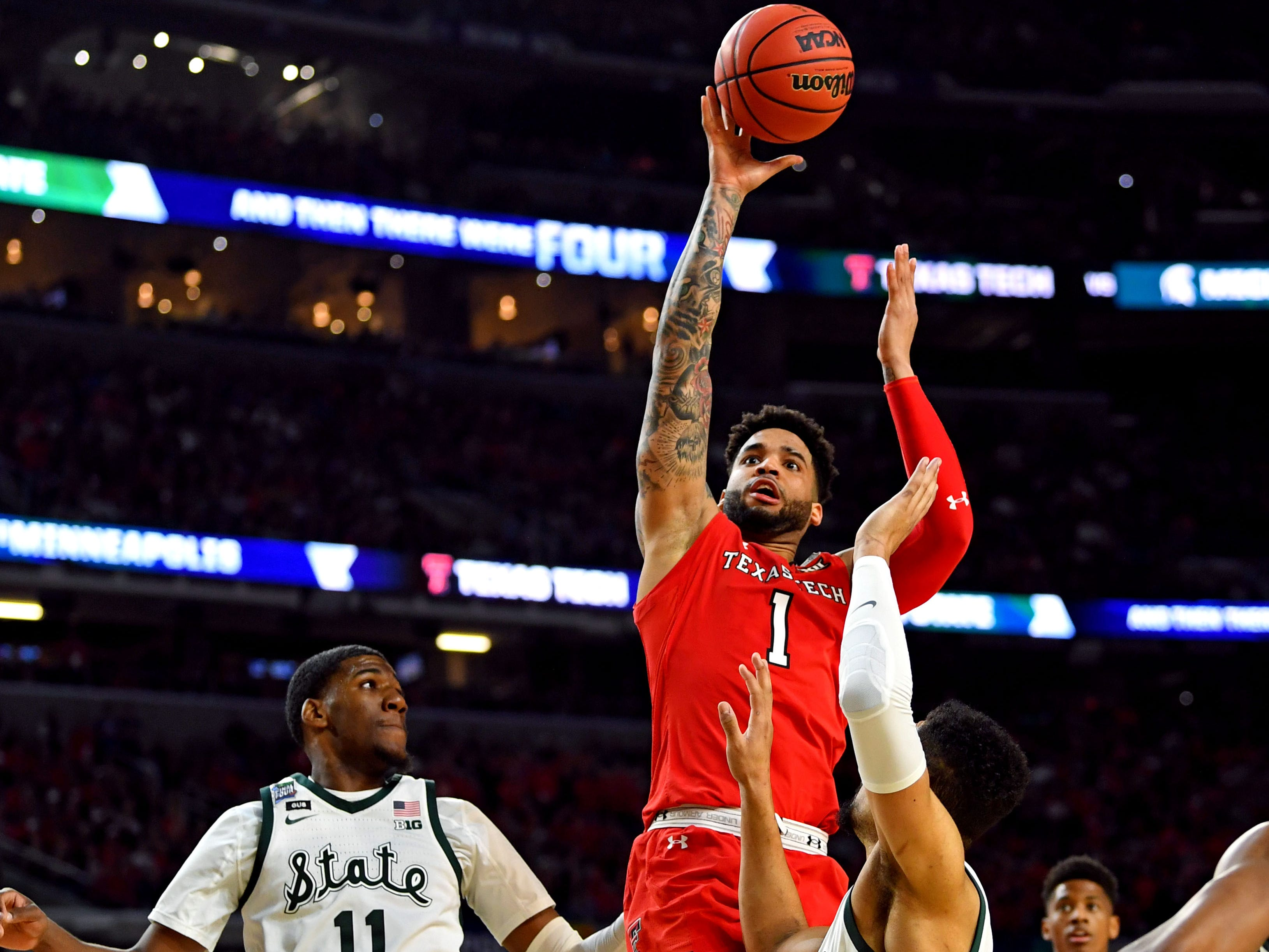 Apr 6, 2019; Minneapolis, MN, USA; Texas Tech Red Raiders guard Brandone Francis (1) shoots the ball against Michigan State Spartans forward Aaron Henry (11) during the first half in the semifinals of the 2019 men's Final Four at US Bank Stadium. Mandatory Credit: Bob Donnan-USA TODAY Sports