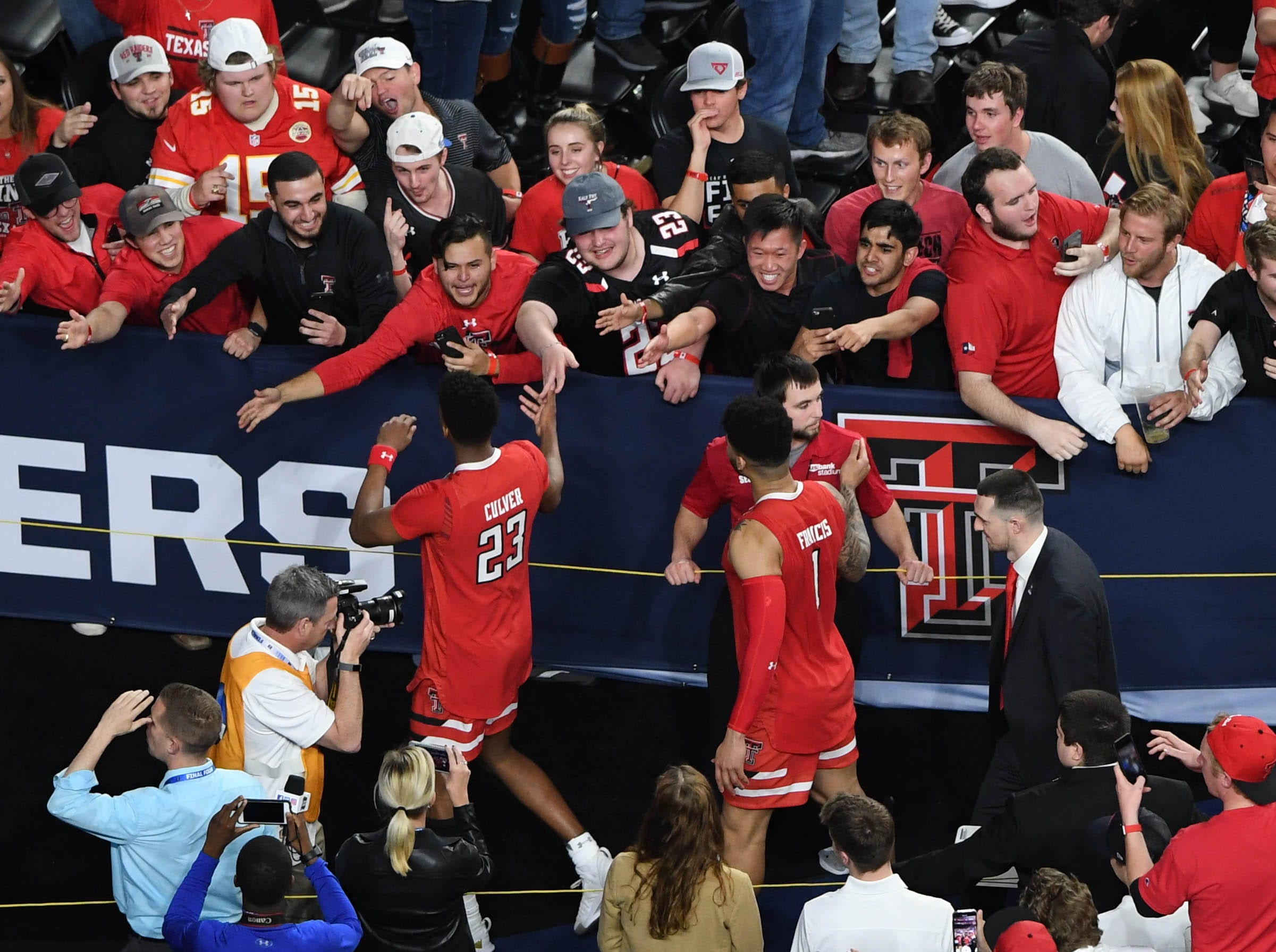 Apr 6, 2019; Minneapolis, MN, USA;Texas Tech Red Raiders guard Jarrett Culver (23) and guard Brandone Francis (1) greet fans after defeating the Michigan State Spartans in the semifinals of the 2019 men's Final Four at US Bank Stadium. Mandatory Credit: Shanna Lockwood-USA TODAY Sports