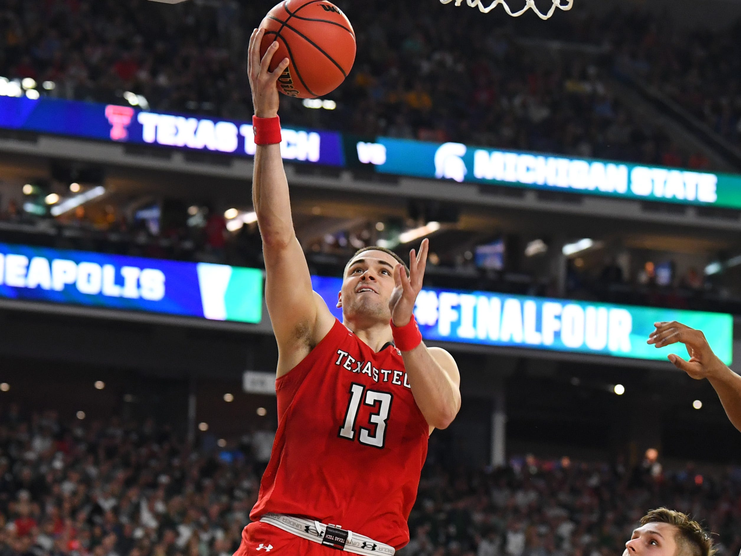 Apr 6, 2019; Minneapolis, MN, USA; Texas Tech Red Raiders guard Matt Mooney (13) lays the ball up past Michigan State Spartans guard Matt McQuaid (20) in the semifinals of the 2019 men's Final Four at US Bank Stadium. Mandatory Credit: Robert Deutsch-USA TODAY Sports