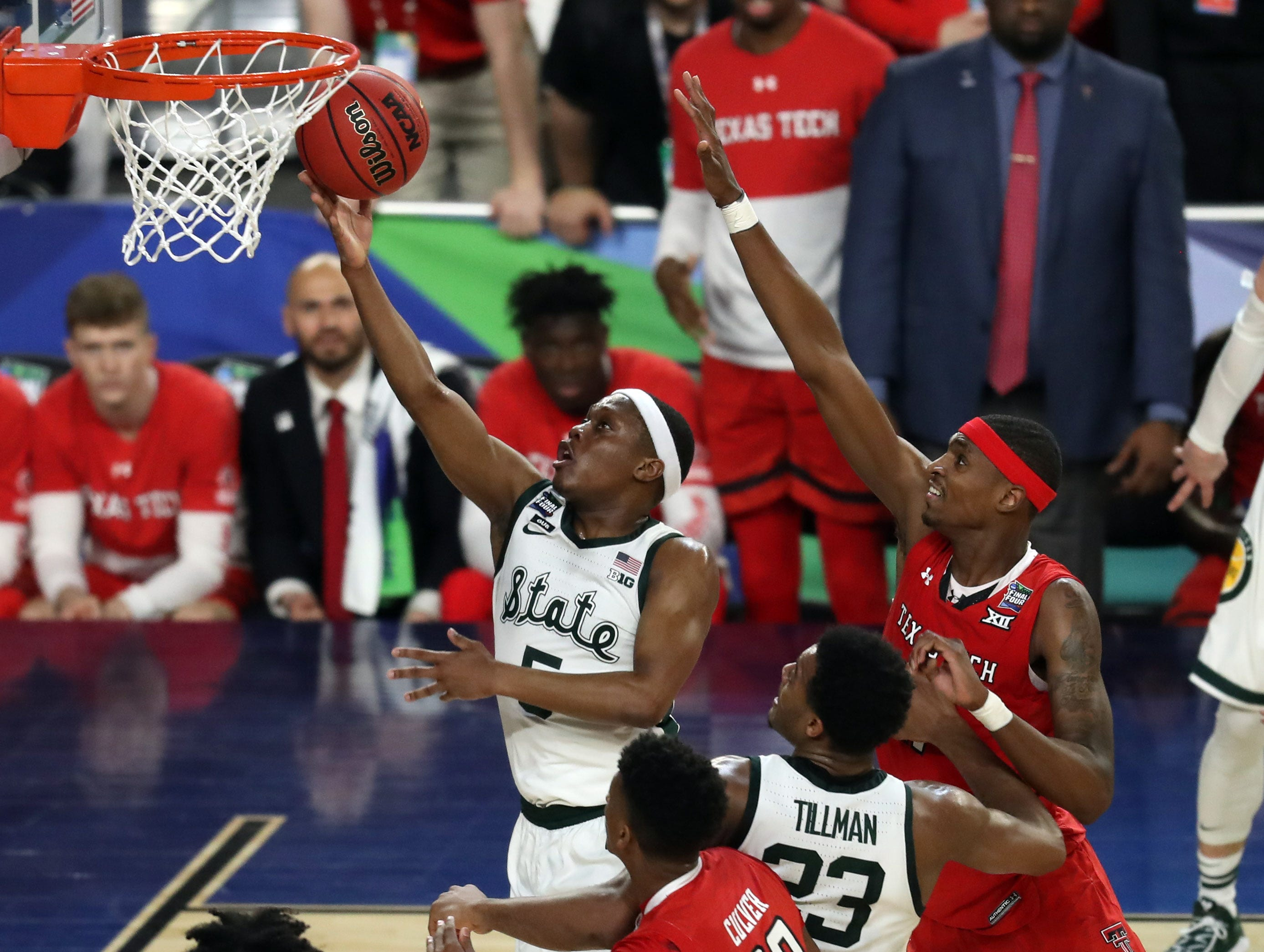 Apr 6, 2019; Minneapolis, MN, USA; Michigan State Spartans guard Cassius Winston (5) drives to the basket during the first half against the Texas Tech Red Raiders in the semifinals of the 2019 men's Final Four at US Bank Stadium. Mandatory Credit: Brace Hemmelgarn-USA TODAY Sports