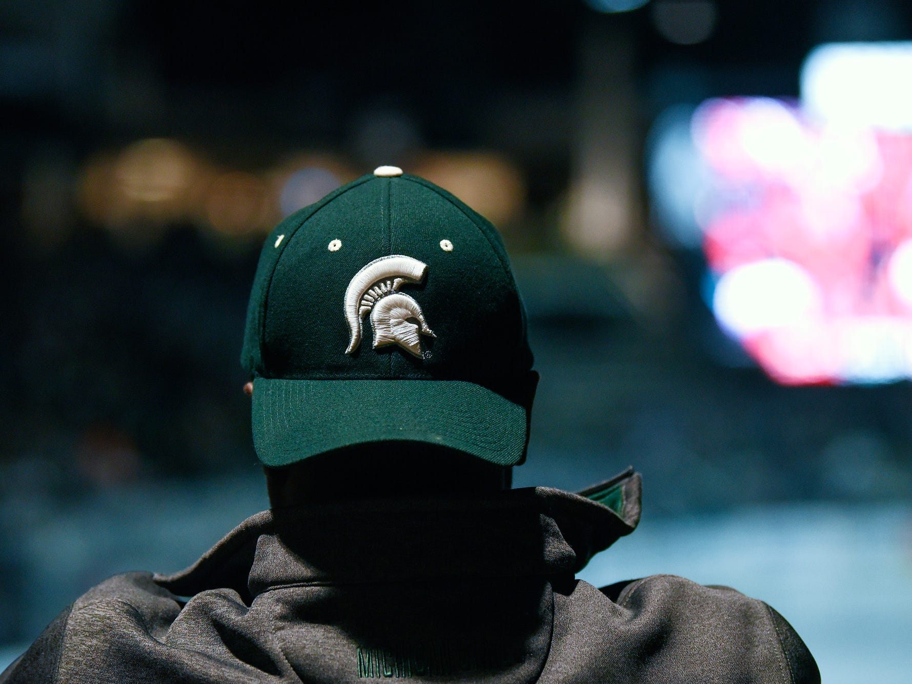 A fan watches the second half of the Michigan State Spartans' Final Four game against Texas Tech on Saturday, April 6, 2019, at a watch party at Munn Ice Arena in East Lansing.