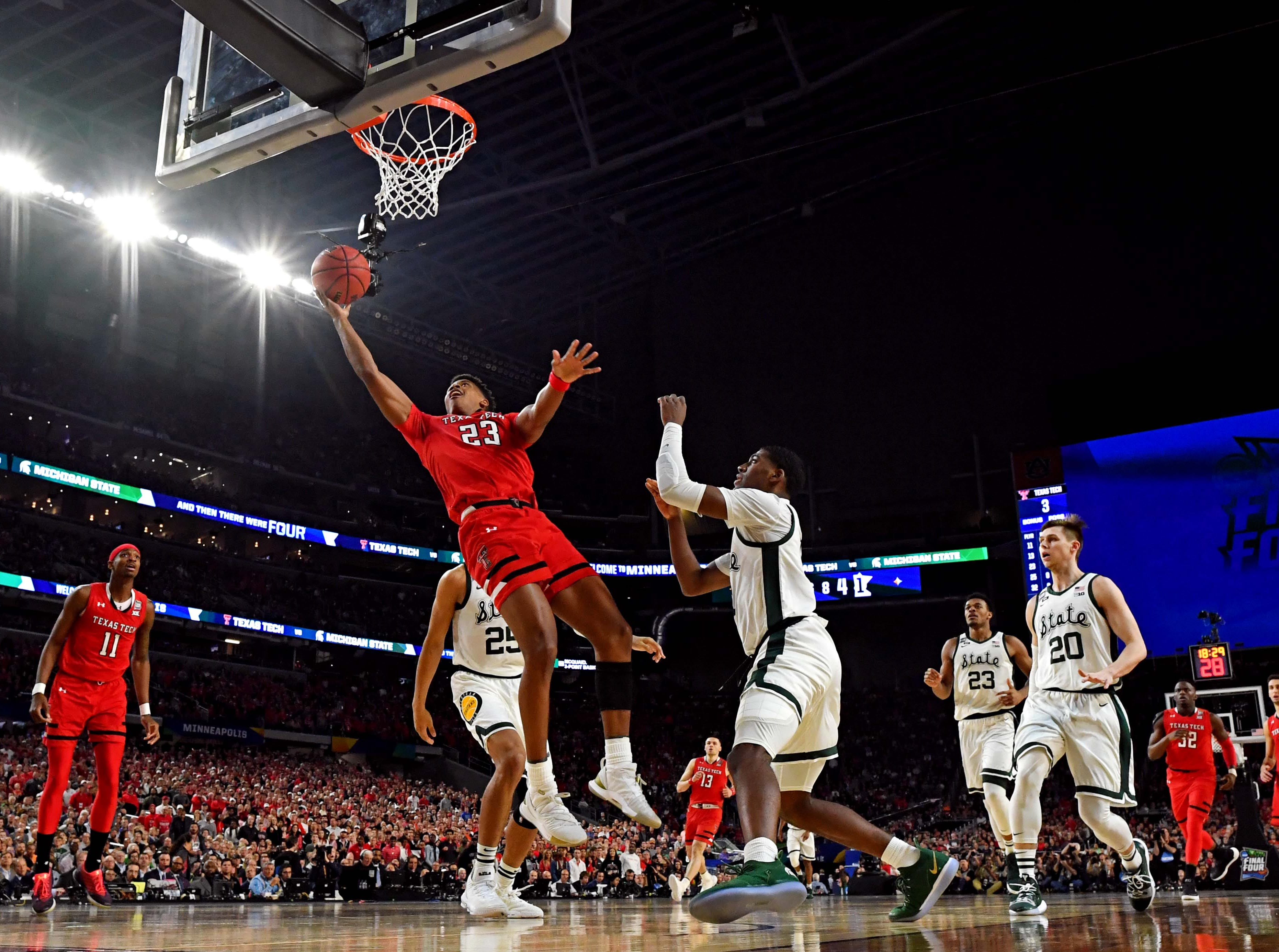 Apr 6, 2019; Minneapolis, MN, USA; Texas Tech Red Raiders guard Jarrett Culver (23) shoots the ball against Michigan State Spartans forward Aaron Henry (11) during the first half in the semifinals of the 2019 men's Final Four at US Bank Stadium. Mandatory Credit: Bob Donnan-USA TODAY Sports