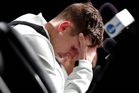 Apr 6, 2019; Minneapolis, MN, USA; Michigan State Spartans guard Matt McQuaid (20) reacts during a press conference after the game against the Texas Tech Red Raiders in the semifinals of the 2019 men's Final Four at US Bank Stadium. Mandatory Credit: Shanna Lockwood-USA TODAY Sports