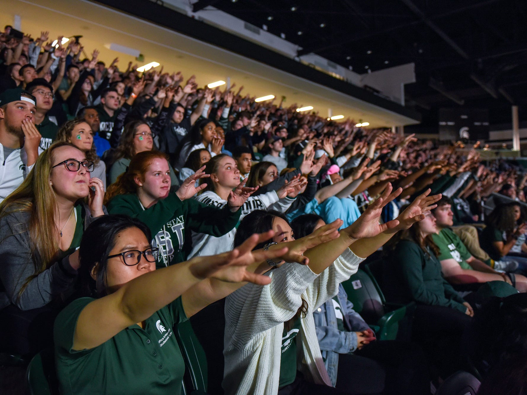 Fans hold their hands up during a Spartan's free throw attempt during Michigan State Spartans' Final Four game against Texas Tech on Saturday, April 6, 2019, at a watch party at Munn Ice Arena in East Lansing.