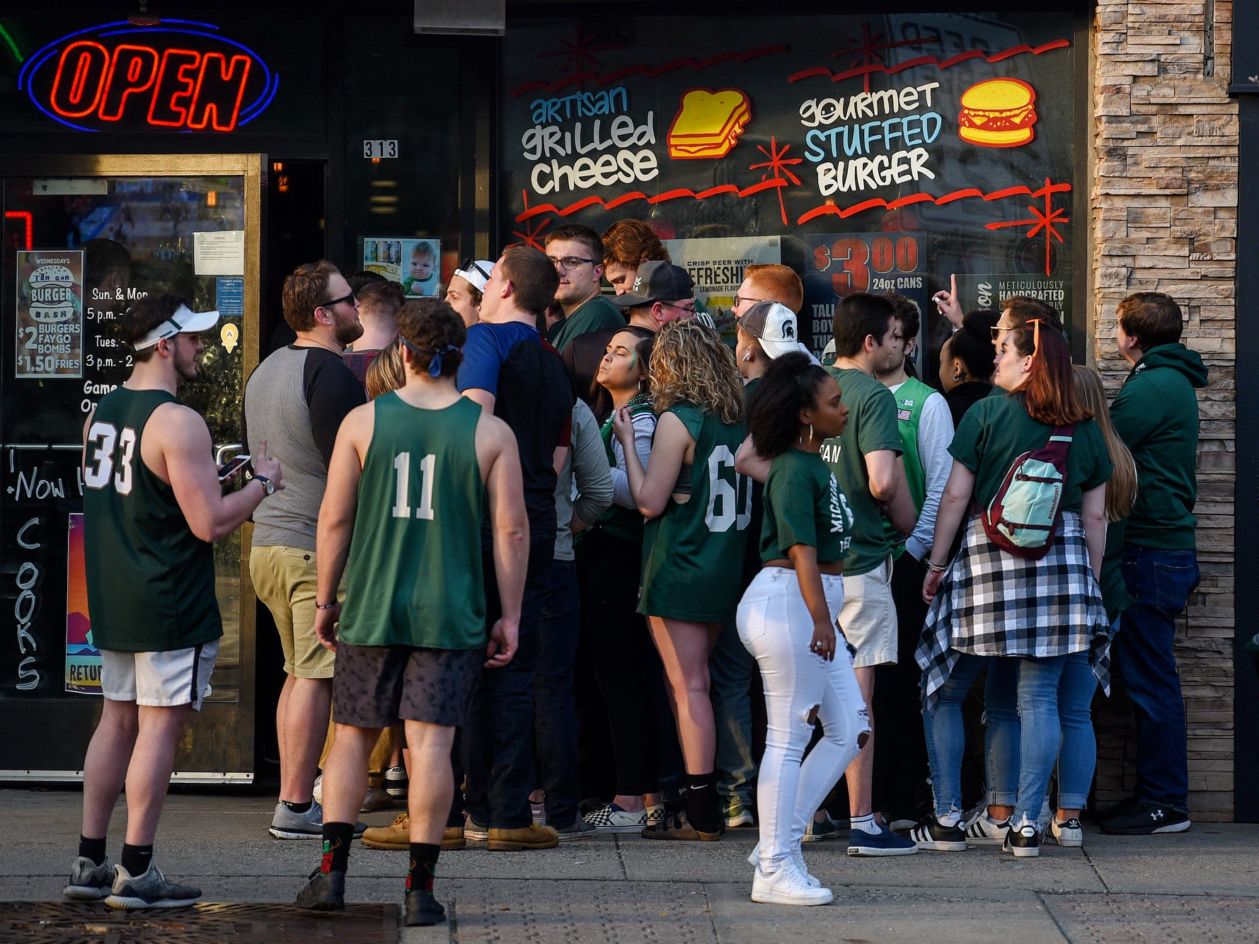 A crowd waits to get inside the Tin Can bar and grill before the Michigan State Spartans' Final Four game against Texas Tech on Saturday, April 6, 2019, in downtown East Lansing.