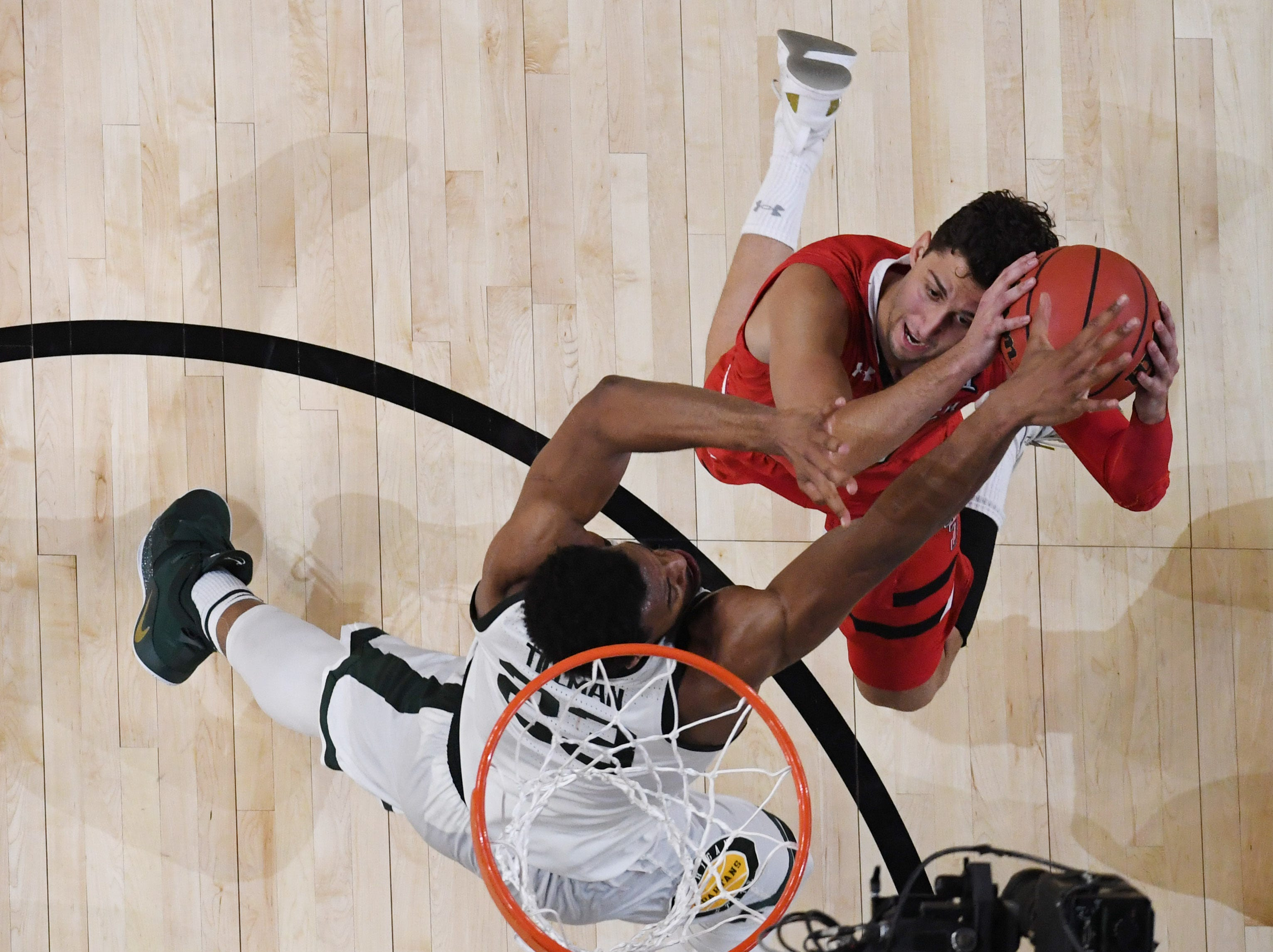 Apr 6, 2019; Minneapolis, MN, USA; Texas Tech Red Raiders guard Davide Moretti (25) shoots against Michigan State Spartans forward Xavier Tillman (23) in the semifinals of the 2019 men's Final Four at US Bank Stadium. Mandatory Credit: Robert Deutsch-USA TODAY Sports