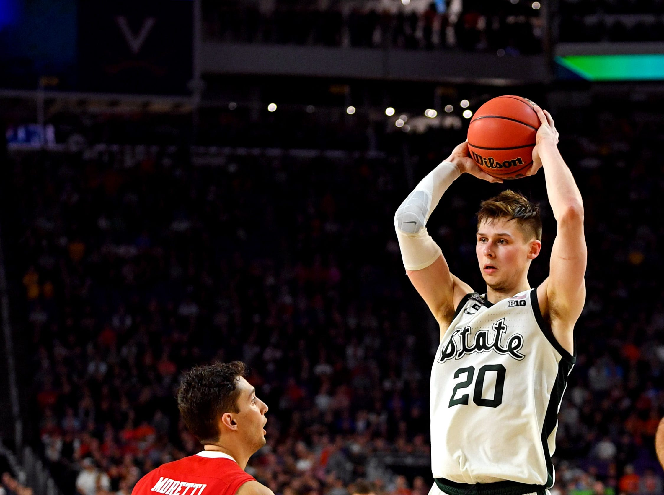 Apr 6, 2019; Minneapolis, MN, USA; Michigan State Spartans guard Matt McQuaid (20) handles the ball against Texas Tech Red Raiders guard Davide Moretti (25) during the second half in the semifinals of the 2019 men's Final Four at US Bank Stadium. Mandatory Credit: Bob Donnan-USA TODAY Sports
