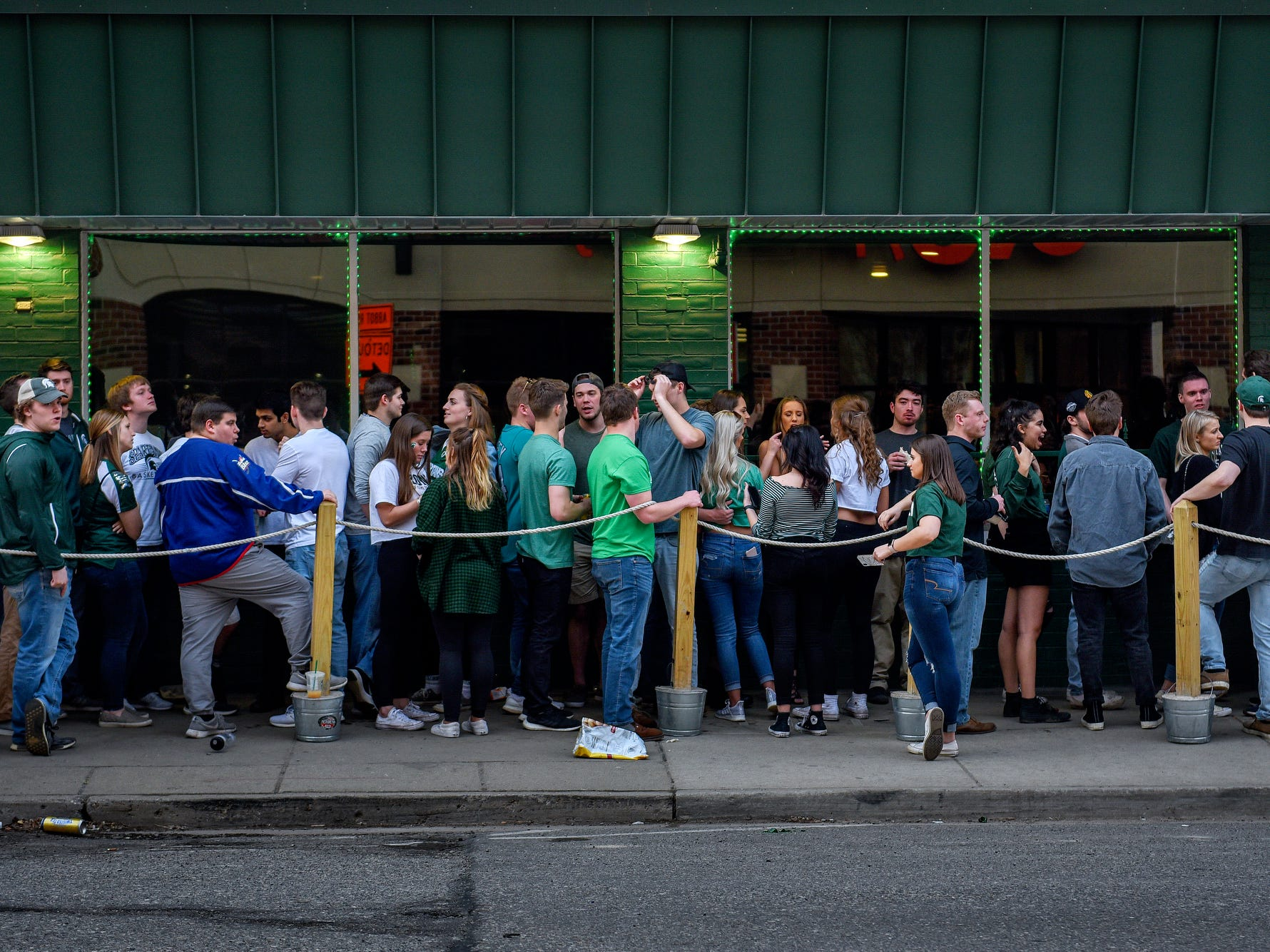 Patrons line the street outside The Riv before the Michigan State Spartans' Final Four game against Texas Tech on Saturday, April 6, 2019, in East Lansing.