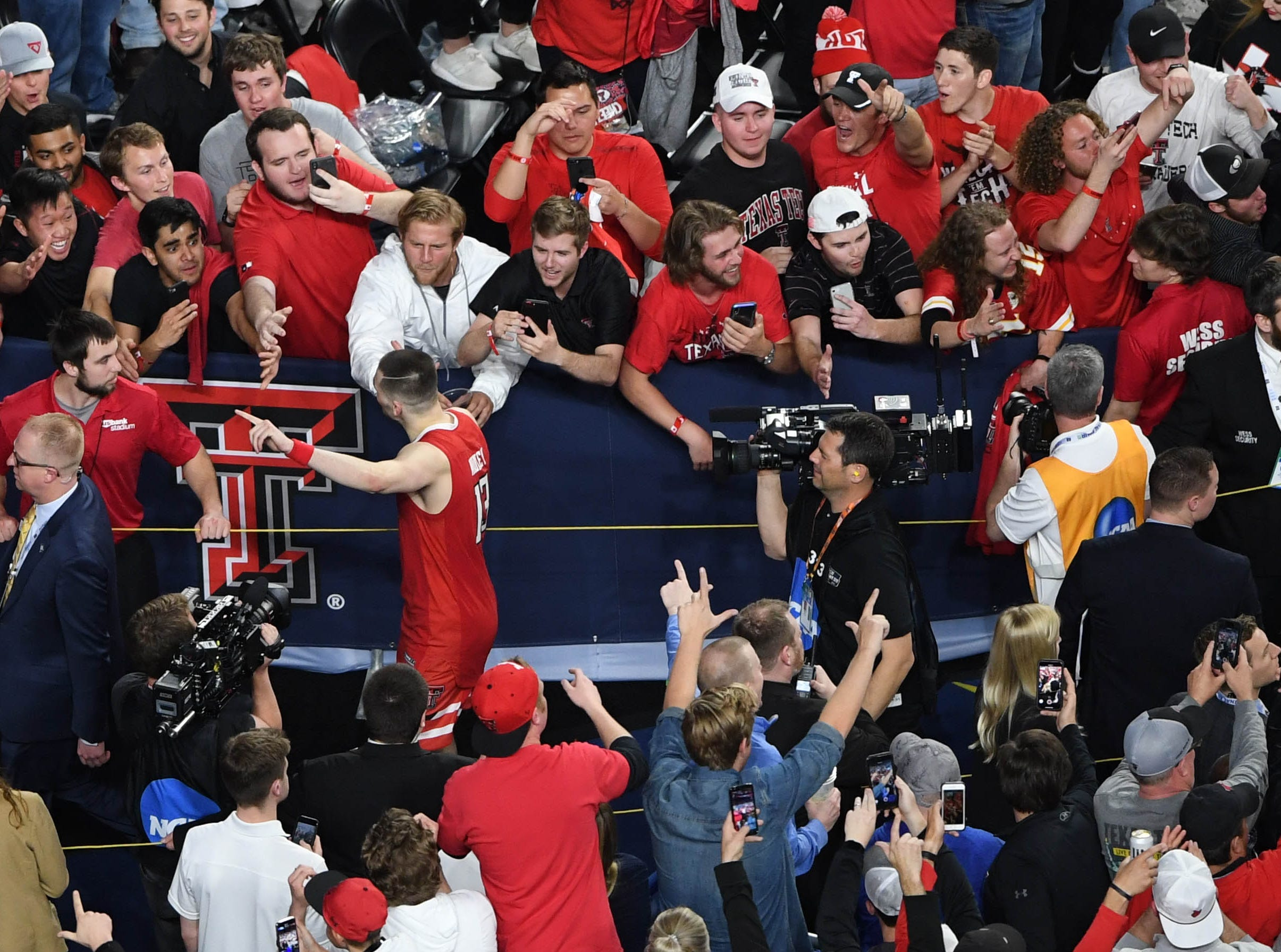 Apr 6, 2019; Minneapolis, MN, USA; Texas Tech Red Raiders guard Matt Mooney (13) greets fans after defeating the Michigan State Spartans in the semifinals of the 2019 men's Final Four at US Bank Stadium. Mandatory Credit: Shanna Lockwood-USA TODAY Sports