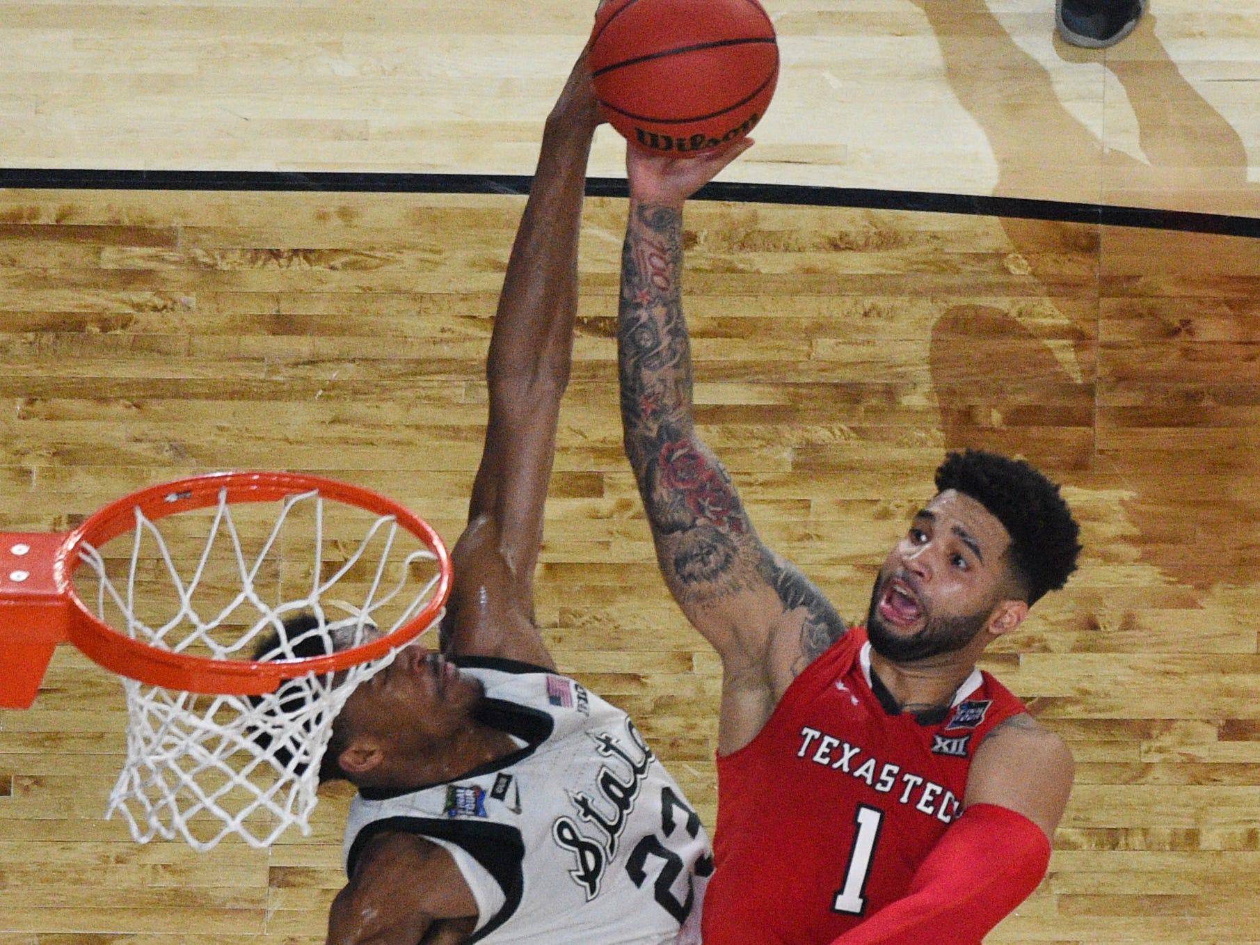 Apr 6, 2019; Minneapolis, MN, USA; Texas Tech Red Raiders guard Brandone Francis (1) shoots against Michigan State Spartans forward Xavier Tillman (23) in the second half in the semifinals of the 2019 men's Final Four at US Bank Stadium. Mandatory Credit: Robert Deutsch-USA TODAY Sports