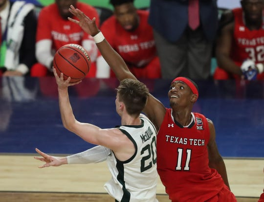 Apr 6, 2019; Minneapolis, MN, USA; Michigan State Spartans guard Matt McQuaid (20) drives to the basket around Texas Tech Red Raiders forward Tariq Owens (11) during the first half in the semifinals of the 2019 men's Final Four at US Bank Stadium. Mandatory Credit: Brace Hemmelgarn-USA TODAY Sports