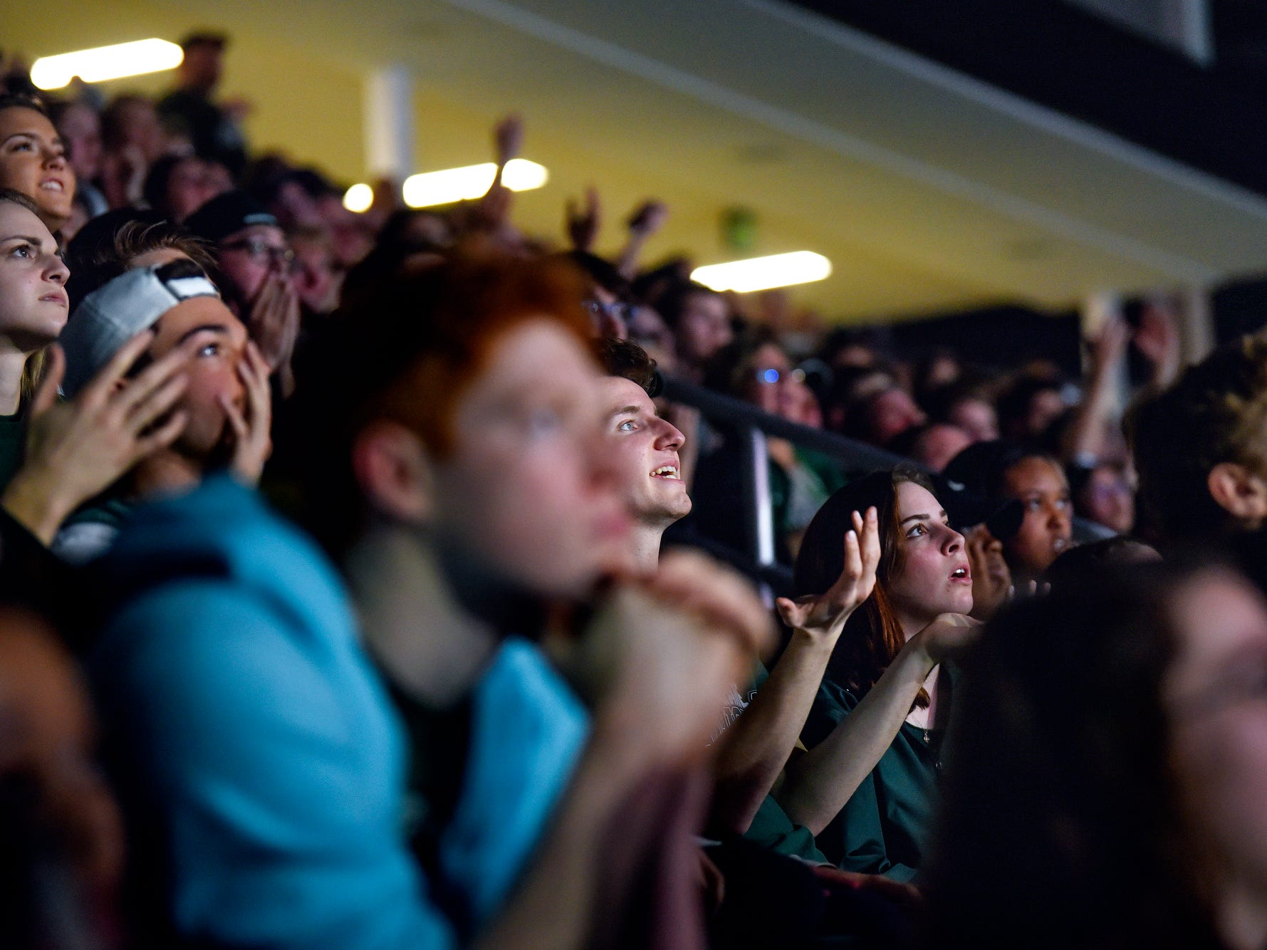 Fans react during the second of half the Michigan State Spartans' Final Four game against Texas Tech on Saturday, April 6, 2019, at a watch party at Munn Ice Arena in East Lansing.