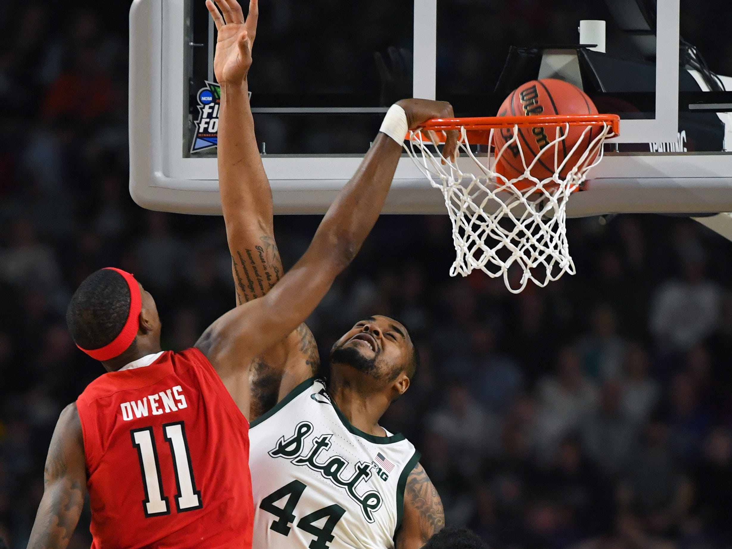 Apr 6, 2019; Minneapolis, MN, USA; Texas Tech Red Raiders forward Tariq Owens (11) dunks the ball over Michigan State Spartans forward Nick Ward (44) in the semifinals of the 2019 men's Final Four at US Bank Stadium. Mandatory Credit: Robert Deutsch-USA TODAY Sports