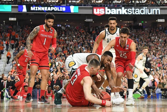 Apr 6, 2019; Minneapolis, MN, USA; Texas Tech Red Raiders guard Matt Mooney (13) dives for the loose ball with Michigan State Spartans forward Nick Ward in the second half in the semifinals of the 2019 men's Final Four at US Bank Stadium. Mandatory Credit: Robert Deutsch-USA TODAY Sports