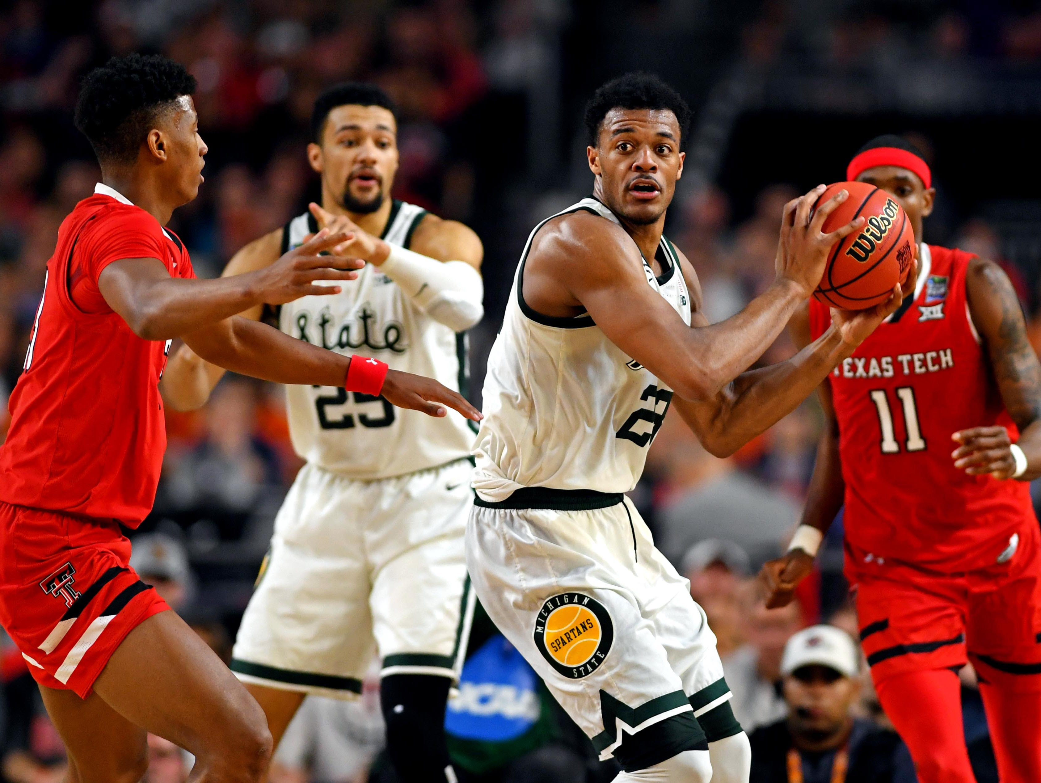 Apr 6, 2019; Minneapolis, MN, USA; Michigan State Spartans forward Xavier Tillman (23) handles the ball against Texas Tech Red Raiders guard Jarrett Culver (23) during the first half in the semifinals of the 2019 men's Final Four at US Bank Stadium. Mandatory Credit: Bob Donnan-USA TODAY Sports
