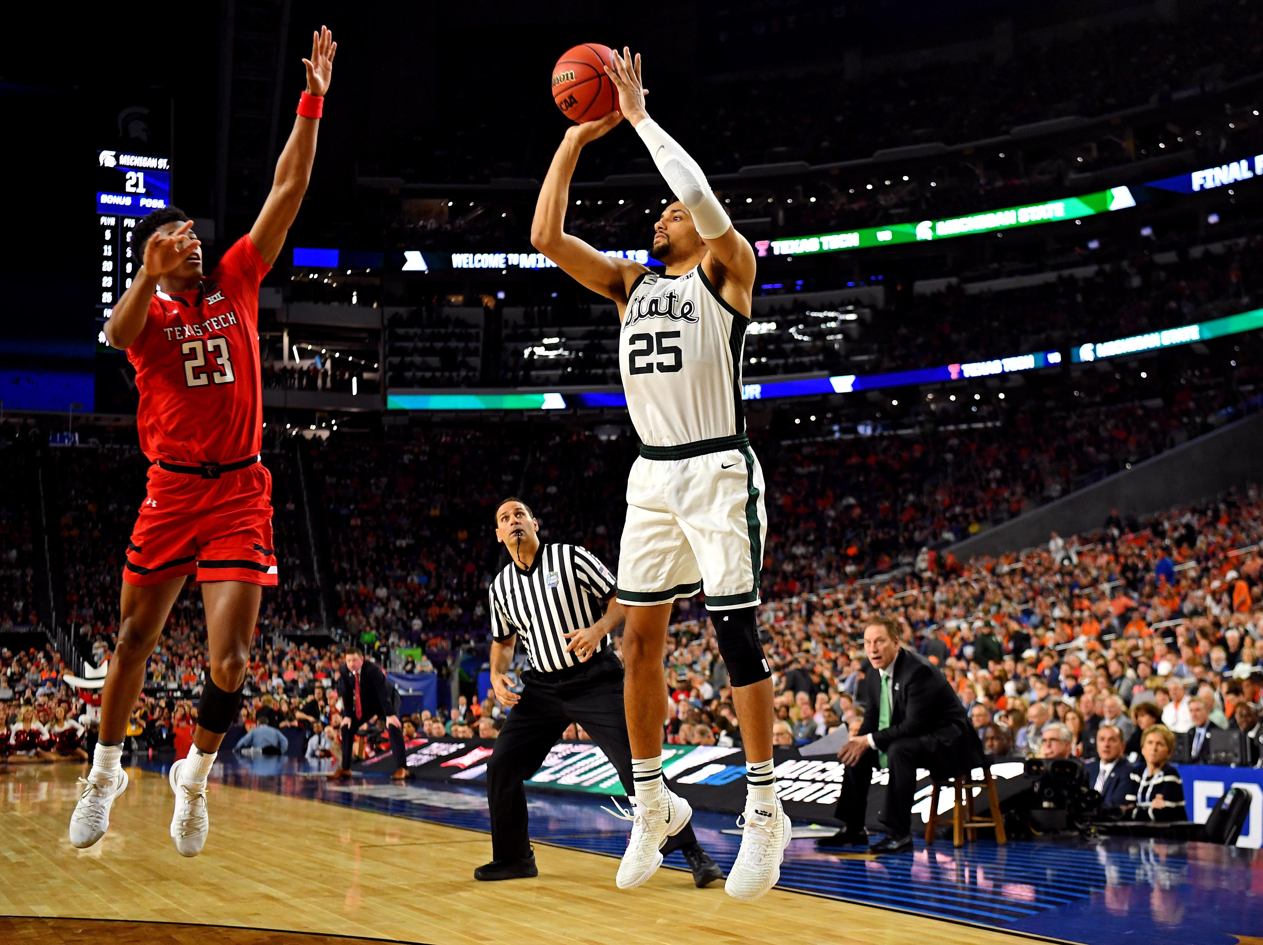 Apr 6, 2019; Minneapolis, MN, USA; Michigan State Spartans forward Kenny Goins (25) shoots the ball against Texas Tech Red Raiders guard Jarrett Culver (23) during the second half in the semifinals of the 2019 men's Final Four at US Bank Stadium. Mandatory Credit: Bob Donnan-USA TODAY Sports