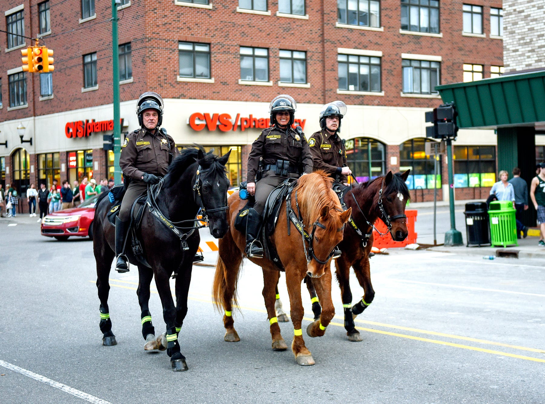 Ingham County Sheriff's Department mounted police patrol on Albert Avenue near the M.A.C. intersection before the Michigan State Spartans' Final Four game against Texas Tech on Saturday, April 6, 2019, in East Lansing.