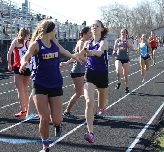 Lexington's Carina Weaver hands the baton to Tessa Gerhardt as their 4x800 relay team took second in Saturday's Lexington Invitational. Weaver would go on to win the 3200.