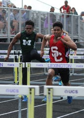 Madison's Jamarius Jones, a triple winner at the season-opening Madison Invitational, competes in the high hurdles at Saturday's Lexington Invitational