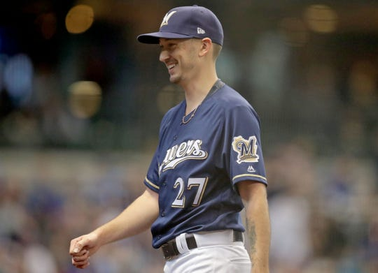 Brewers starter Zach Davies is all smales after pitching a scoreless fifth.
