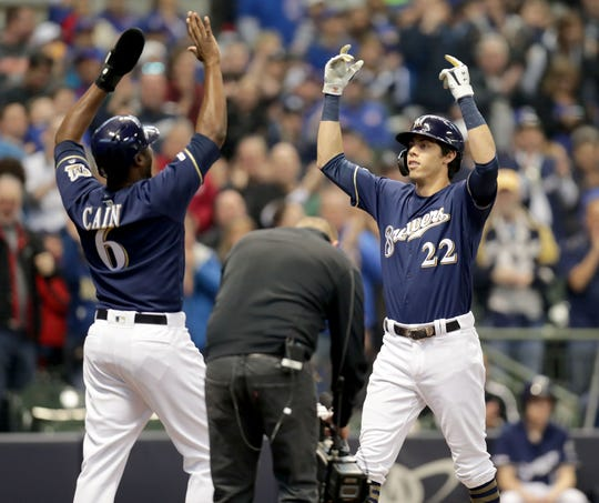 Milwaukee Brewers right fielder Christian Yelich (22) celebrates his home run with Milwaukee Brewers center fielder Lorenzo Cain (6) during the 1st inning of the Milwaukee Brewers vs. Chicago Cubs in the MLB game at Miller Park in Milwaukee on Sunday, April 7, 2019. Photo by Mike De Sisti/Milwaukee Journal Sentinel  ORG XMIT: DBY1