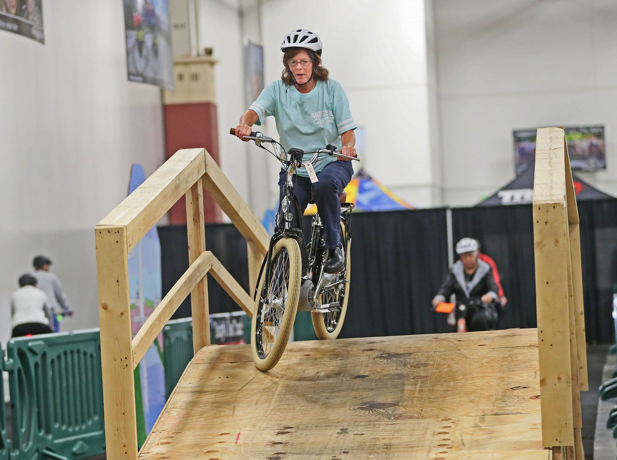 Kimberly Ferrie of Milwaukee tests out an eBike on the electric bike test track.  The bikes have an electric motor and battery in additon to pedal power. The electric motor can assist powering a rider a little or a lot depending the rider's preference.