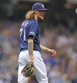 Brewers reliever Josh Hader is pumped after recording the final out against the Cubs.
